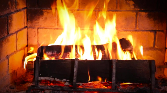 A fire burning in a fireplace.